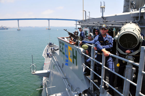 Sailors aboard missile cruiser