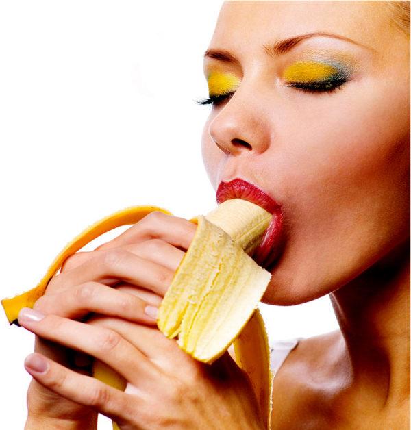 women sucking a banana