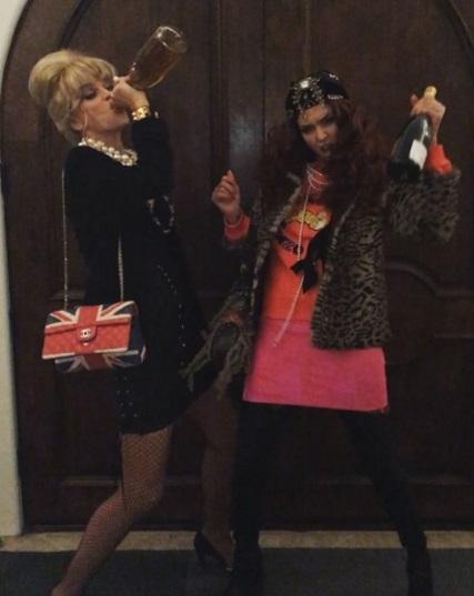 Jessica Alba and friend dressed as ab fab stars